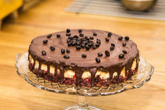 Delicious sweet baked cake with coffee beans and fruit Royalty Free Stock Photos