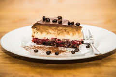 Delicious sweet baked cake with coffee beans and fruit Stock Photography