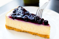 Delicious Sweet Blueberry Cheesecake. Delicious and Sweet Blueberry Cheesecake on White Dish , Ready to Serve Stock Photos