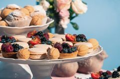 Delicious sweet buffet with cupcakes, macaroons, other desserts, blue design stock image