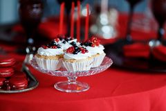 Delicious sweet buffet with cupcakes on red table Royalty Free Stock Photo