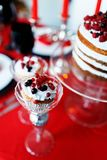 Delicious sweet buffet with cupcakes on red table Royalty Free Stock Images