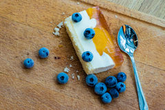 Delicious and sweet cake with blueberries. Sunny dessert on the Royalty Free Stock Photo
