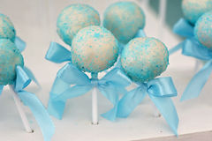 Delicious sweet candies, decorated in wedding style. With bows and colored custard Royalty Free Stock Photo