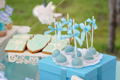 Delicious sweet candies, decorated in wedding style. With bows and colored custard Stock Photos