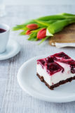 Delicious and sweet cheesecake with cherry jelly Stock Images