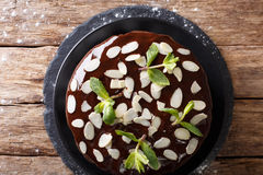 Delicious sweet chocolate cake with whipped cream and almond clo Stock Photos