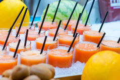 Delicious sweet cocktails and fresh fruits in the shop with takeaway Royalty Free Stock Image