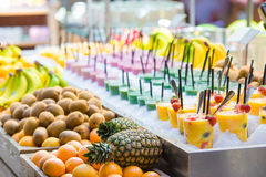 Delicious sweet cocktails and fresh fruits in the Royalty Free Stock Images