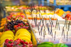 Delicious sweet cocktails and fresh fruits in the Royalty Free Stock Photo