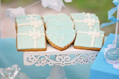 Delicious sweet cookies, decorated in wedding style. With bows and colored custard of frosting Stock Photo