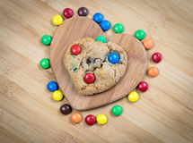 Delicious sweet cookies and heart shape Stock Image
