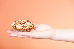 Delicious sweet cupcake in human hand. Gluttony Royalty Free Stock Photo