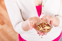 Delicious sweet cupcake in human hand. Royalty Free Stock Images