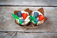 Delicious, sweet cupcakes decorated with cream, chocolate cream, cinnamon, cocoa.decorated with fresh, natural, organic fruit, sug stock image