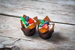 Delicious, sweet cupcakes decorated with cream, chocolate cream, cinnamon, cocoa.decorated with fresh, natural, organic fruit, sug. Delicious, sweet cupcakes Royalty Free Stock Image
