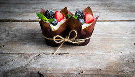 Delicious, sweet cupcakes decorated with cream, chocolate cream, cinnamon, cocoa.decorated with fresh, natural, organic fruit, sug. Delicious, sweet cupcakes Stock Photos