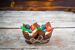 Delicious, sweet cupcakes decorated with cream, chocolate cream, cinnamon, cocoa.decorated with fresh, natural, organic fruit, sug. Delicious, sweet cupcakes Stock Images