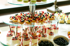 Delicious sweet cupcakes and pastry at wedding  dessert table re Stock Images