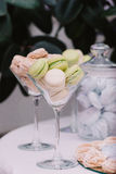 Delicious sweet cupcakes in vases, decorated in wedding style Royalty Free Stock Photo