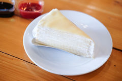 Delicious sweet dessert bakery layer crepe cake. On white dish Royalty Free Stock Photo