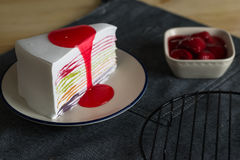 Delicious sweet dessert bakery rainbow color layer crepe cake wi. Th fresh strawberry sauce ,selective focus Stock Images
