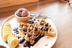 Delicious sweet dessert : homemade waffle with chocolate sauce Royalty Free Stock Photos