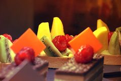 Delicious SWEET DESSERT ,UAE ON FEBRUARY 22 2017. Fruits and chocolate pastry with raspberry on top,UAE ON FEBRUARY 22 2017. Sweet dessert, tasty and delicious Royalty Free Stock Photo