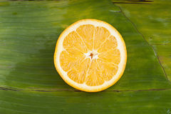 Delicious sweet fresh cut orange on banana leaf Stock Photo