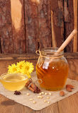 Delicious sweet honey with dipper in glass jar. Royalty Free Stock Photography
