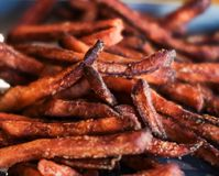 Delicious sweet potato fries close up picture. stock photos