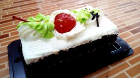 Delicious sweet Vanilla Cream Chocolate Cake Royalty Free Stock Photos