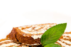 Delicious swiss roll with cream cheese. Royalty Free Stock Images