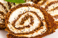 Delicious swiss roll with cream cheese. Stock Photos