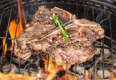 Delicious t-bone steak on fire Stock Images