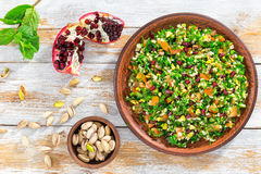 Delicious tabbouleh salad with pomegranate, pistachio nuts stock photos