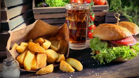 Delicious takeaway burger with cold drink and fries stock footage
