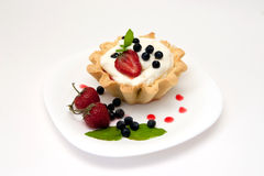 Delicious tart with berries and cream Stock Images
