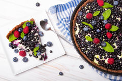 Delicious tart with blueberries and raspberries Stock Images
