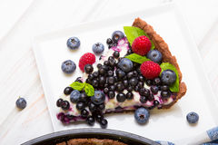 Delicious tart with blueberries and raspberries Royalty Free Stock Photo