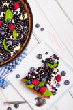 Delicious tart with blueberries and raspberries Royalty Free Stock Image