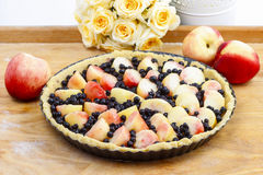 Delicious tart filled with peaches and blueberries Stock Image
