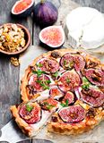 Delicious  tart  with fresh figs and goat cheese on rustic wooden Royalty Free Stock Images