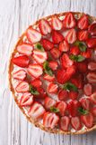 Delicious tart with fresh strawberries closeup vertical top view Stock Photo