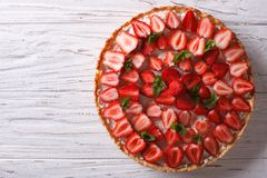 Delicious tart with fresh strawberries horizontal top view Royalty Free Stock Photo