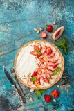 Delicious Tart with peaches and strawberries Stock Images