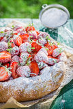 Delicious tart with strawberries in sunny day Royalty Free Stock Photos