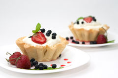 Delicious tarts with berries and cream Royalty Free Stock Photo