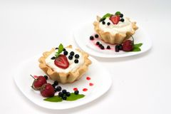 Delicious tarts with berries and cream Stock Images