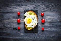 Delicious Tasty Avocado Eggs and Tomato Cheese Toasts Stock Photo